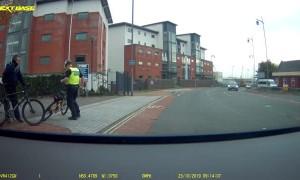Biking Policeman Takes a Tumble Chasing Criminal