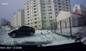Quick Thinking Driver Reverses Away from Sliding Car