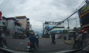 Truck Runs Red Light and Gives Rider a Fright