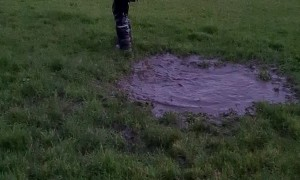 Kid Makes an Unexpected Jump into Mud Puddle