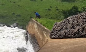 Dog Washed over Dam Wall is Rescued