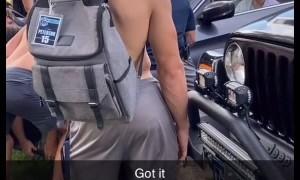 Football Team Helps Lift Girl's Car Back over Curb