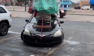 Car Carries Large Load on Rooftop