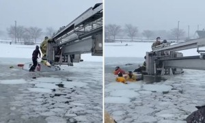 Firefighters rescue two people from submerged truck