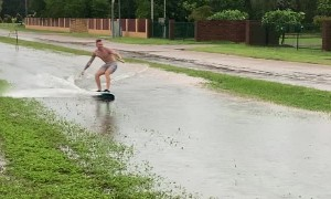 Dudes in Darwin Make the Most of Wet Weather
