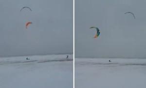Kite surfing on frozen Lake Michigan during Chicago winter storm