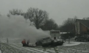 Police Officer and Good Samaritans pull driver from burning car