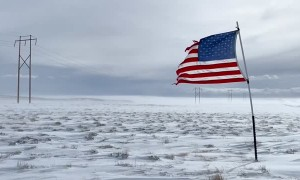 American Flag Blowing in Freezing Landscape