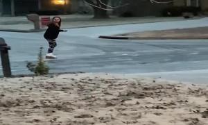 Girl Blissfully Ice Skates around Neighborhood