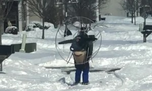 Heavy snow no match for guy wearing skis and high powered fan