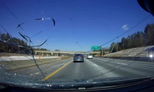 Flying Sheet of Ice Shatters Windshield on Interstate