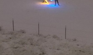 Two Men Having a Light Saber Duel in the Snow