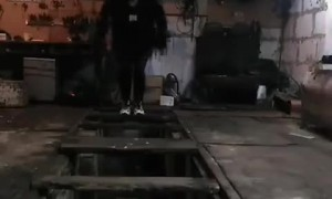 Man Jumping on Wooden Boards Unexpectedly Falls