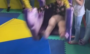 Girl Sent Flying by Swing to the Face