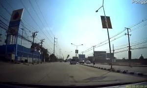 Car Has Close Call with Truck Making U-Turn