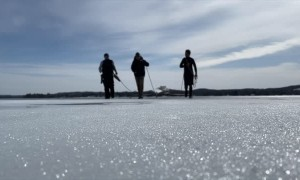 Iceboat Rescued After Getting Frozen in Lake