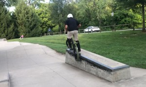 Kid Practicing BMX Goes Over the Handlebars