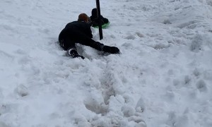 Guy Intercepts Sledding Kiddo from Pole