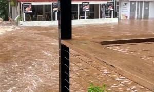 Floods Turn Creek Into Raging Torrent