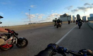 Rider Performing Wheelie Nearly Falls Off Overpass