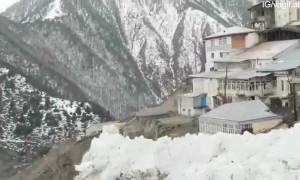 Avalanche in Narrow Valley Village