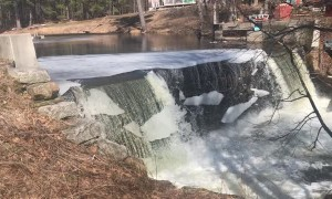 Ice Sheet Crumbles Off Waterfall