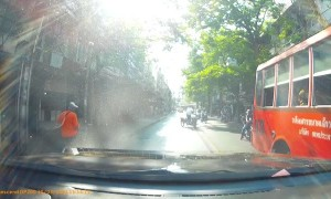 Motorist Has Close Call with Oncoming Bus