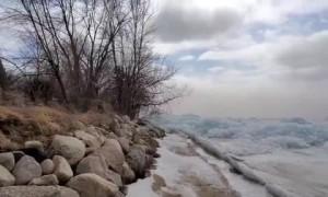 Strong winds cause massive ice pileups on Minnesota lake