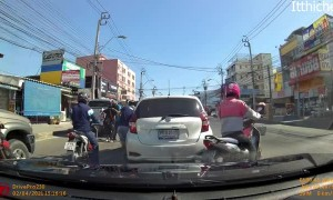 Lane-Splitting Motorcyclist Meets Open Car Door
