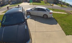 Father Narrowly Escapes Out of Control Car in Driveway