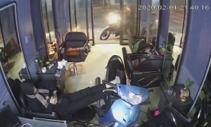 Scooter Crashes into Shop