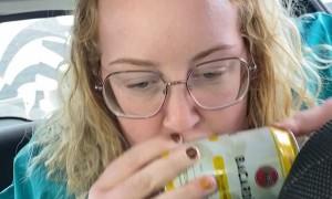 Girl Has Her Beverage Backward