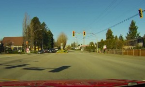 Car Ignores Red Light and Narrowly Misses Pedestrian