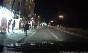 Roadside Scuffle Gets Close to Car