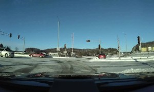 Car in a Hurry Slides Haphazardly Through Intersection