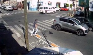 Pedestrian Falls Flat on His Face at Crosswalk