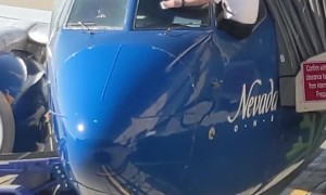 Airline Pilots Manually Wipe Windshield before Flight