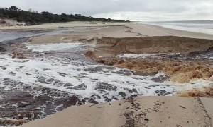 Lagoon Breaks Through the Sand Into the Sea