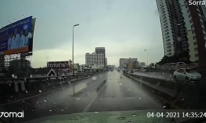Slippery Corner Sends Car Bouncing Between Barriers