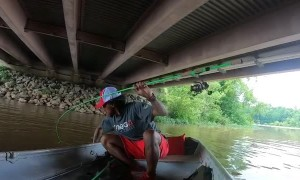 Fisherman Trades The Rod for the Fish