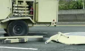 Military Hummer Jackknifes on Highway