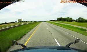 Truck Tips Into Ditch on Interstate
