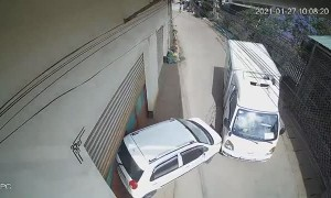 Runaway Truck Pushes Parked Car Into Building