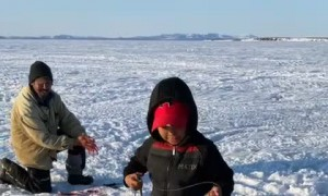 Boy Catches Fish The Same Size as Himself
