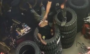 Man Accidentally Gets Head Stuck in Tire Stack