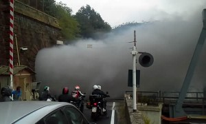 Onlookers Watch In Awe As Old-Fashioned Steam Train Exits Tunnel