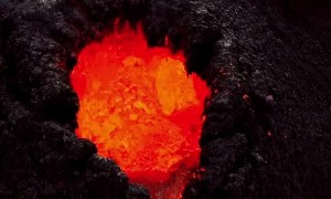 Helicopter footage captures up-close images of erupting volcano