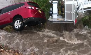 Portales Fire Department Saves Family From Car Swept by Floodwaters