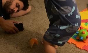 Boy Bonks Dad with Bucket