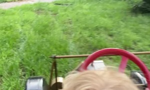 Boy Takes Dad for a Tour in Miniature Model T